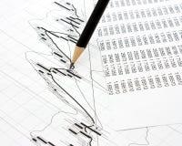 Bleistifte auf den Grafiken Lizenzfreie Stockfotos