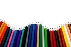 Bleistifte durch eine Welle Stockbilder