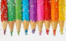 Bleistifte im Wasser Lizenzfreie Stockfotos