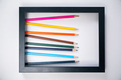 Bleistifte innerhalb des Bilderrahmens Stockfotos