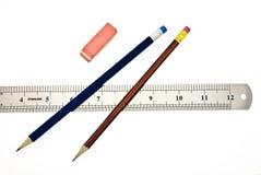 Bleistifte, Radiergummi und Tabellierprogramm Stockfotos