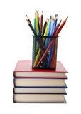 Bleistifte und Bücher Stockbild