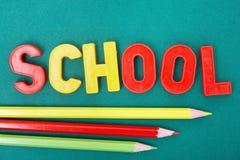 Bleistifte und Buchstaben Lizenzfreie Stockfotos