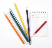 Bleistifte und Notizbuch Stockbild