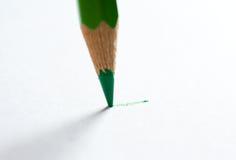 Bleistiftschreiben auf Papier Lizenzfreie Stockfotos
