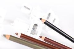 Bleistiftspitzer und Make-upbleistifte Lizenzfreie Stockfotos