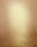 Blek guld- och bruntbakgrund med tappninggrunge bedrövade textur Arkivbilder