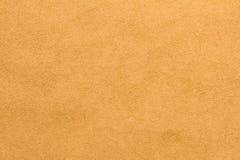 Bleke goldenrod de textuurachtergrond van de gipspleistermuur royalty-vrije stock afbeelding