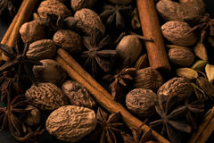 Blend of cinnamon, anise, nutmeg and cardamon spices dark photo closeup macro pattern. Blend of cinnamon, anise, nutmeg and cardamon spices dark photo royalty free stock photos