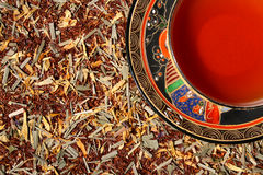 Blend of premium tea leaves and chinese tea cup Royalty Free Stock Images
