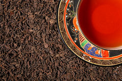 Blend of premium tea leaves and chinese tea cup Royalty Free Stock Photography