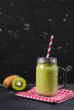 Blended fresh green smoothie with kiwi and spinach.  Royalty Free Stock Image