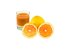 Blended grapefruit. Small grass of blended grapefruit and sliced of orange on white background Royalty Free Stock Images