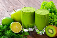 Blended green smoothie with ingredients selective Stock Photography