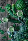 Blended green smoothie with ingredients Royalty Free Stock Photos