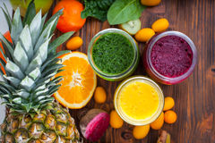 Blended green, yellow and purple smoothie with ingredients. Selective focus stock photos