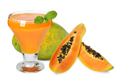 Blended papaya juice. Fresh blended papaya juice with a mint leaf over white background Royalty Free Stock Photography