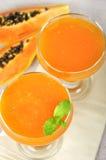Blended papaya juice. Fresh blended papaya juice with a mint leaf Royalty Free Stock Photo