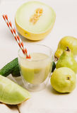 Blended smoothie with pear,cumumber and melon Stock Photos