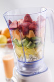 Blender. Mixed fresh fruit in blender close up stock photo