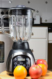 Blender. With whole raw fruit with a kitchen background stock photos