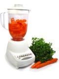 Blender. Isolated blender making carrot juice stock images