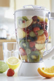 Blender filled with fresh fruits close-up Royalty Free Stock Photography