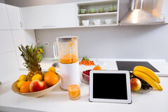 Blender with fresh fruit drink and tablet pc Stock Image