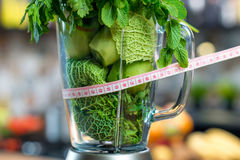 Blender with green ingredients Royalty Free Stock Photos