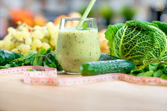 Blender with green ingredients Stock Image