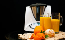 Blender or mixer with oranges Stock Photography