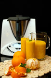 Blender Or Mixer With Oranges Stock Image