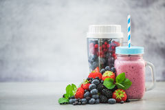 Blender ready for making berry smoothie. And ingredients stock images