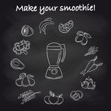 Blender and smoothie ingredients on chalkboard Royalty Free Stock Images