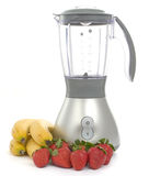 Blender with strawberries and bananas Stock Photo