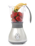 Blender with strawberries and bananas Stock Image
