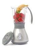 Blender with strawberries and one banana Stock Images