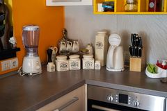 Kitchen Counter. Blender sugar bowl pepper pot coffee pot spaghetter nd oven etc royalty free stock photography