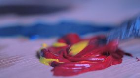 Blending oil paint with a brush close-up. Blue purple tone color stock video