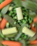Blending Vegetables. Vegetables spinning as if in a blender or juicer royalty free stock photo