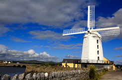 Blennerville Windmill, Ireland. Blennerville Windmill - white windmill with the blue sky with clouds background in Tralee Bay (town of Blennerville, Ireland) Stock Images