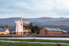 Blennerville Windmill. The Windmill at Blennerville, just on the outskirts of Tralee town. The evening sun is illumination the building and it`s surroundings Stock Photo