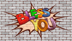 Bless you inscription on the wall of white brick. Stock Photography