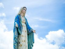 The Blessed Virgin Mary Statue blue sky background.  royalty free stock photos