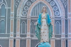 The Blessed Virgin Mary statue standing in front of the Roman Catholic Diocese with blue sky background at Chanthaburi Province. Royalty Free Stock Photo