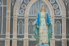 The Blessed Virgin Mary statue standing in front of The Roman Catholic Diocese. Royalty Free Stock Photography