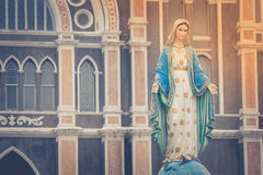The Blessed Virgin Mary statue standing in front of The Roman Catholic Diocese that is public place. Stock Photo