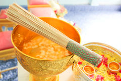 Blessed water at Thai wedding ceremony. Royalty Free Stock Photography