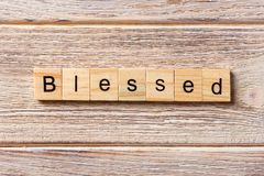 Blessed word written on wood block. Blessed text on table, concept.  royalty free stock photo