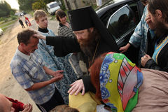 Blessing. Russia. Tomsk. Rostislav - Archbishop of Tomsk and Asino, blesses the people on the street. Orthodox celebrations devoted to the second finding of a Stock Image